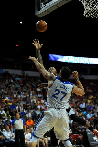 Jul 22, 2013; Las Vegas, NV, USA; Phoenix Suns forward P.J. Tucker attempts to score a basket against Golden State Warriors center Dwayne Jones during the NBA Summer League Championship game at the Thomas and Mack Center. Mandatory Credit: Stephen R. Sylvanie-USA TODAY Sports
