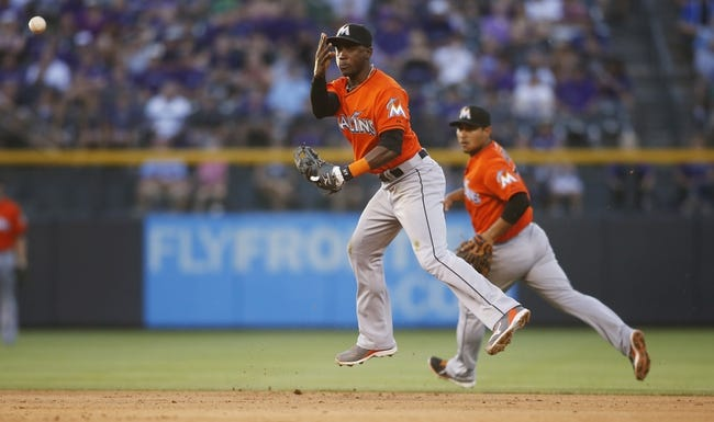 Jul 22, 2013; Denver, CO, USA; Miami Marlins shortstop Adeiny Hechavarria (3) fields a ground ball during the fourth inning against the Colorado Rockies at Coors Field. Mandatory Credit: Chris Humphreys-USA TODAY Sports