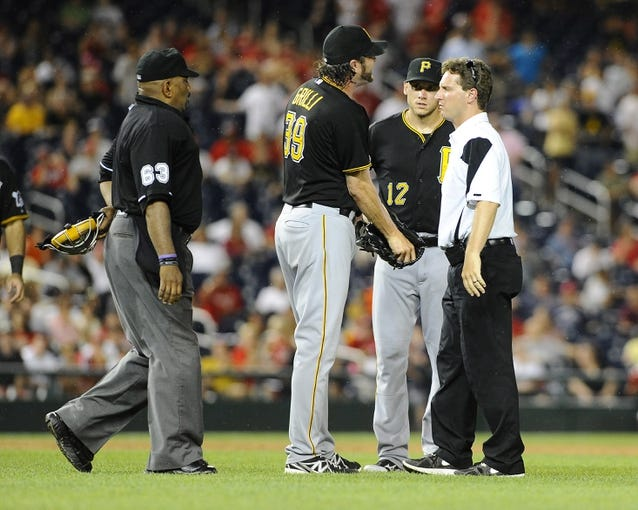 Jul 22, 2013; Washington, DC, USA; Pittsburgh Pirates relief pitcher Jason Grilli (39) meets with a trainer after suffering an apparent arm injury during the ninth inning against the Washington Nationals at Nationals Park.  Mandatory Credit: Brad Mills-USA TODAY Sports