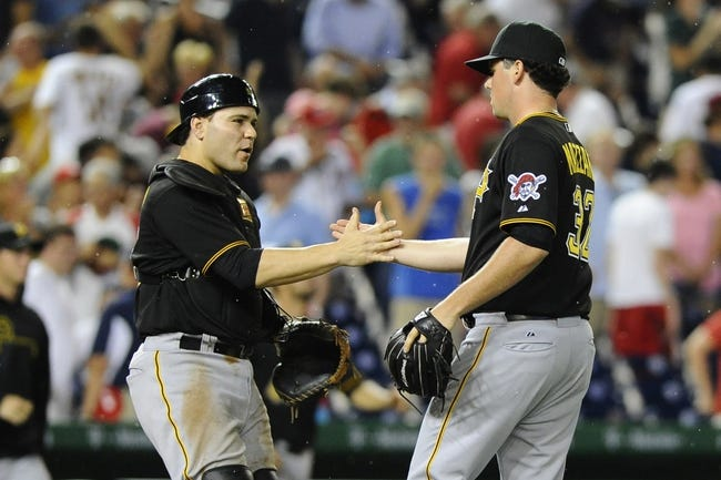 Jul 22, 2013; Washington, DC, USA; Pittsburgh Pirates relief pitcher Vin Mazzaro (32) is congratulated by catcher Russell Martin (55) after recording the final out against the Washington Nationals at Nationals Park.  Mandatory Credit: Brad Mills-USA TODAY Sports