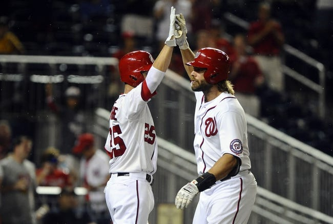 Jul 22, 2013; Washington, DC, USA; Washington Nationals right fielder Jayson Werth (28) is congratulated by Adam LaRoche (25) after hitting a two run home run during the ninth inning against the Pittsburgh Pirates at Nationals Park. Mandatory Credit: Brad Mills-USA TODAY Sports