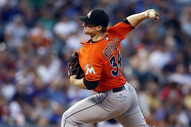 Jul 22, 2013; Denver, CO, USA;Miami Marlins pitcher Tom Koehler (34) delivers a pitch during the fifth inning against the Colorado Rockies at Coors Field. Mandatory Credit: Chris Humphreys-USA TODAY Sports