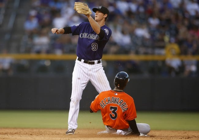 Jul 22, 2013; Denver, CO, USA; Miami Marlins shortstop Adeiny Hechavarria (3) steals second base before Colorado Rockies second baseman DJ LeMahieu (9) can make the tag during the fifth inning at Coors Field. Mandatory Credit: Chris Humphreys-USA TODAY Sports