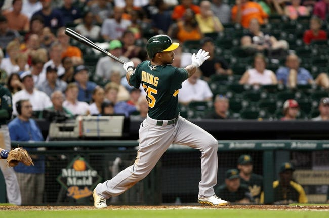 Jul 22, 2013; Houston, TX, USA; Oakland Athletics center fielder Chris Young (25) hits a home run during the seventh inning against the Houston Astros at Minute Maid Park. Mandatory Credit: Troy Taormina-USA TODAY Sports