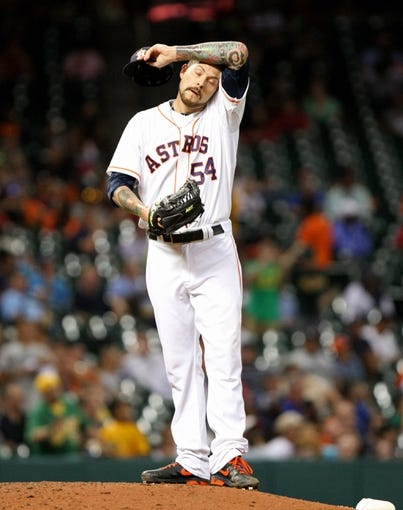 Jul 22, 2013; Houston, TX, USA; Houston Astros relief pitcher Travis Blackley (54) reacts after giving up a home run during the seventh inning against the Oakland Athletics at Minute Maid Park. Mandatory Credit: Troy Taormina-USA TODAY Sports