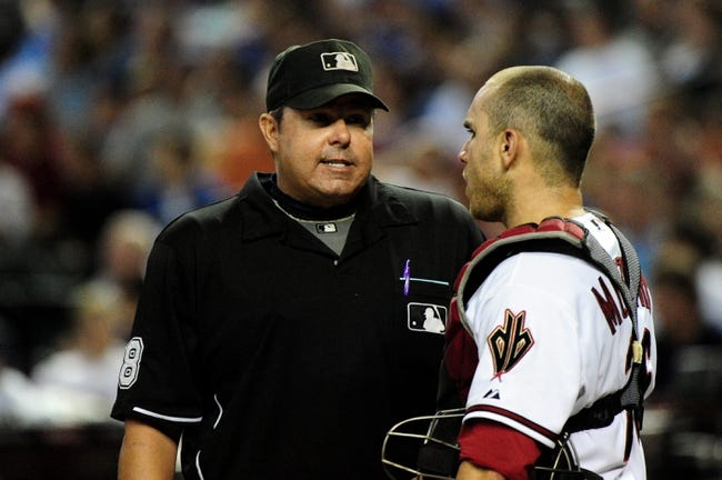 Jul 22, 2013; Phoenix, AZ, USA; Umpire Doug Eddings talks with Arizona Diamondbacks catcher Miguel Montero (26) during the fourth inning against the Chicago Cubs at Chase Field. Mandatory Credit: Matt Kartozian-USA TODAY Sports