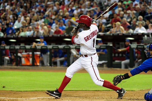Jul 22, 2013; Phoenix, AZ, USA; Arizona Diamondbacks shortstop Didi Gregorius (1) hits a single during the third inning against the Chicago Cubs at Chase Field. Mandatory Credit: Matt Kartozian-USA TODAY Sports