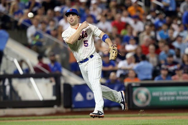 Jul 22, 2013; New York, NY, USA;  New York Mets third baseman David Wright (5) throws to first for an out during the sixth inning against the Atlanta Braves at Citi Field.  Atlanta Braves won 2-1.  Credit: Anthony Gruppuso-USA TODAY Sports