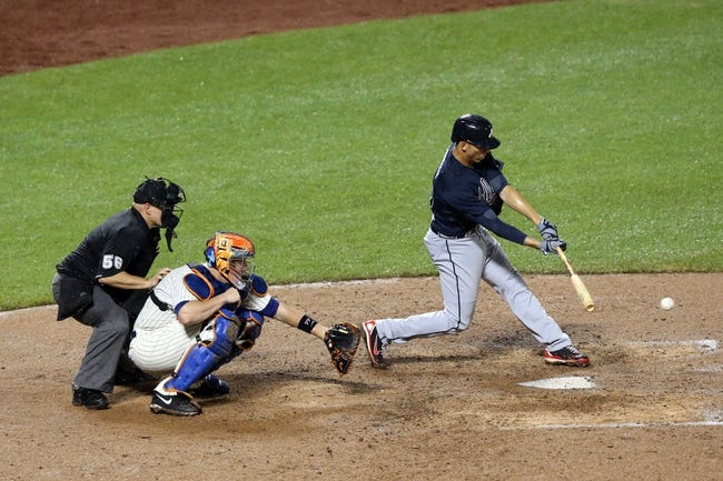 Jul 22, 2013; New York, NY, USA;  Atlanta Braves shortstop Andrelton Simmons (19) singles to center during the eighth inning against the New York Mets at Citi Field.  Atlanta Braves won 2-1.  Credit: Anthony Gruppuso-USA TODAY Sports
