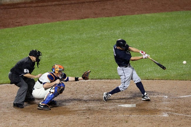 Jul 22, 2013; New York, NY, USA;  Atlanta Braves right fielder Reed Johnson (7) singles to center allowing a runner to score during the ninth inning against the New York Mets at Citi Field.  Atlanta Braves won 2-1.  Credit: Anthony Gruppuso-USA TODAY Sports