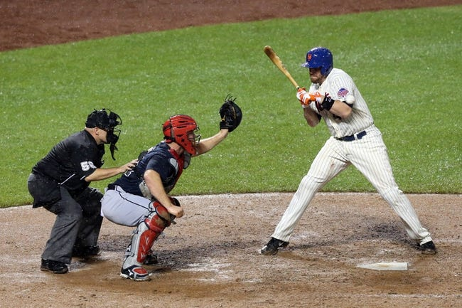 Jul 22, 2013; New York, NY, USA;  New York Mets catcher John Buck (44) gets hit with a wild pitch during the ninth inning against the Atlanta Braves at Citi Field.  Atlanta Braves won 2-1.  Credit: Anthony Gruppuso-USA TODAY Sports
