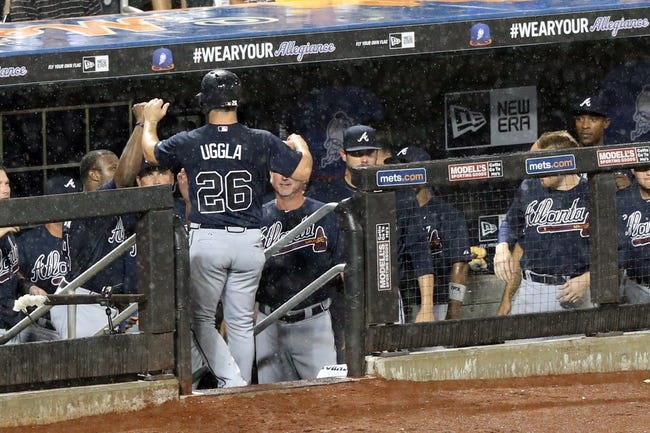 Jul 22, 2013; New York, NY, USA;  Atlanta Braves second baseman Dan Uggla (26) celebrates scoring as he enters the dugout during the ninth inning against the New York Mets at Citi Field.  Atlanta Braves won 2-1.  Credit: Anthony Gruppuso-USA TODAY Sports