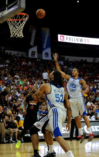 Jul 22, 2013; Las Vegas, NV, USA; Golden State Warriors forward Lance Goulbourne takes a shot against the Phoenix Suns during the NBA Summer League Championship game at the Thomas and Mack Center. Also pictured are Phoenix Suns forward Marcus Morris (left), and Golden State Warriors center Gary McGhee (center). Golden State won the game 91-77 to remain undefeated during the Summer League games. Mandatory Credit: Stephen R. Sylvanie-USA TODAY Sports
