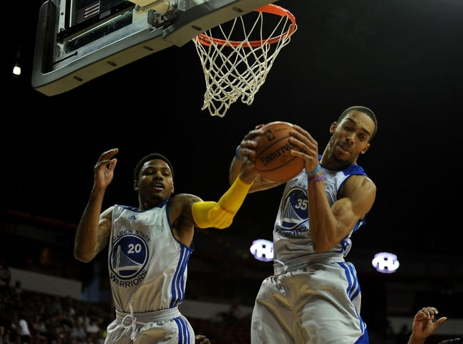 Jul 22, 2013; Las Vegas, NV, USA; Golden State Warriors guard Kent Bazemore and forward Lance Goulbourne combine for a defensive rebound against the Phoenix Suns during the NBA Summer League Championship game at the Thomas and Mack Center. The Warriors won the game 91-77 to remain undefeated in the Summer League games. Mandatory Credit: Stephen R. Sylvanie-USA TODAY Sports