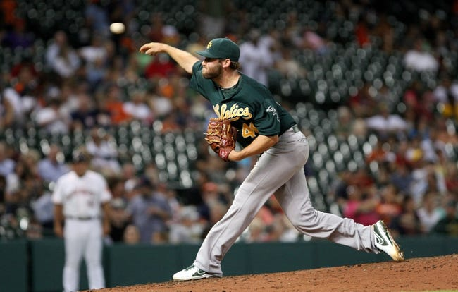 Jul 22, 2013; Houston, TX, USA; Oakland Athletics relief pitcher Ryan Cook (48) pitches during the sixth inning against the Houston Astros at Minute Maid Park. Mandatory Credit: Troy Taormina-USA TODAY Sports