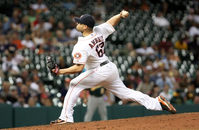 Jul 22, 2013; Houston, TX, USA; Houston Astros relief pitcher Hector Ambriz (62) pitches during the eighth inning against the Oakland Athletics at Minute Maid Park. Mandatory Credit: Troy Taormina-USA TODAY Sports