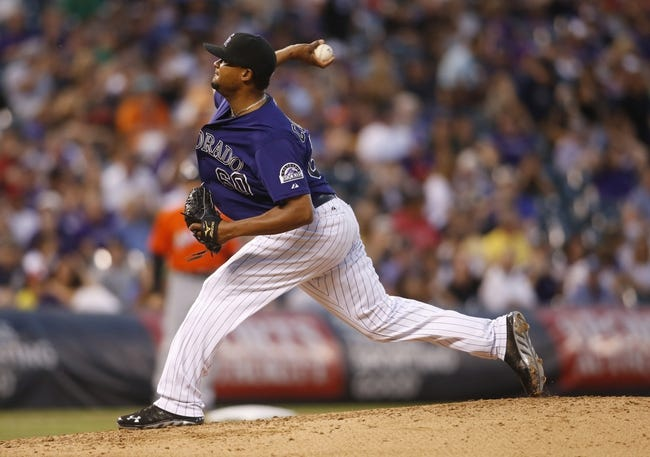 Jul 22, 2013; Denver, CO, USA; Colorado Rockies pitcher Manny Corpas (60) delivers a pitch during the sixth inning against the Miami Marlins at Coors Field. Mandatory Credit: Chris Humphreys-USA TODAY Sports