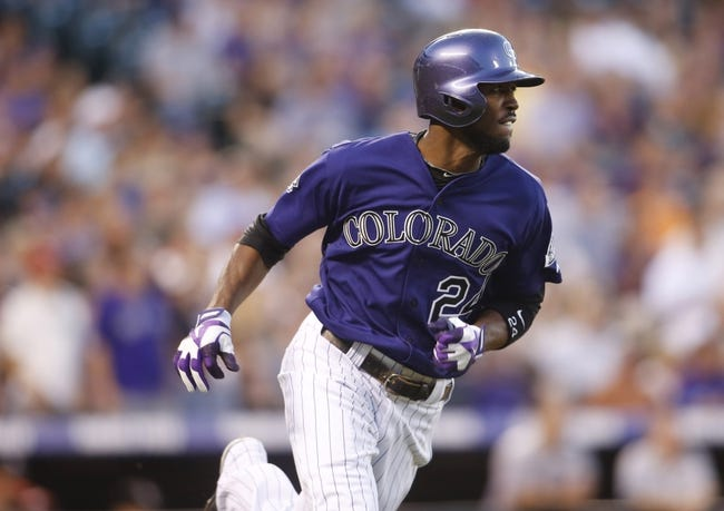 Jul 22, 2013; Denver, CO, USA; Colorado Rockies center fielder Dexter Fowler (24) during the fifth inning against the Miami Marlins at Coors Field. Mandatory Credit: Chris Humphreys-USA TODAY Sports