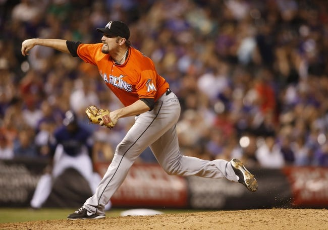 Jul 22, 2013; Denver, CO, USA; Miami Marlins pitcher Chad Qualls (50) delivers a pitch during the eighth inning against the Colorado Rockies at Coors Field. Mandatory Credit: Chris Humphreys-USA TODAY Sports