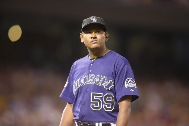 Jul 22, 2013; Denver, CO, USA; Colorado Rockies pitcher Wilton Lopez (59) walks to the dugout during the eighth inning against the Miami Marlins at Coors Field. Mandatory Credit: Chris Humphreys-USA TODAY Sports