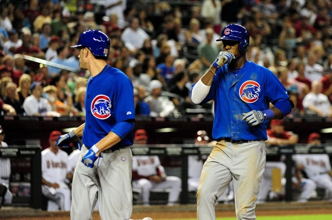 Jul 22, 2013; Phoenix, AZ, USA; Chicago Cubs shortstop Junior Lake (21) celebrates with pitcher Chris Rusin after hitting a two run home run during the fifth inning against the Arizona Diamondbacks at Chase Field. Mandatory Credit: Matt Kartozian-USA TODAY Sports
