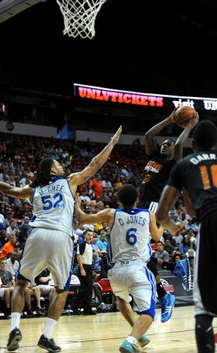 Jul 22, 2013; Las Vegas, NV, USA; Phoenix Suns guard Archie Goodwin attempts a shot against Golden State center Gary McGhee (left) and guard Cameron Jones during the NBA Summer League Championship game at the Thomas and Mack Center. Golden State won the game 91-77 to remain undefeated during the Summer League games. Mandatory Credit: Stephen R. Sylvanie-USA TODAY Sports