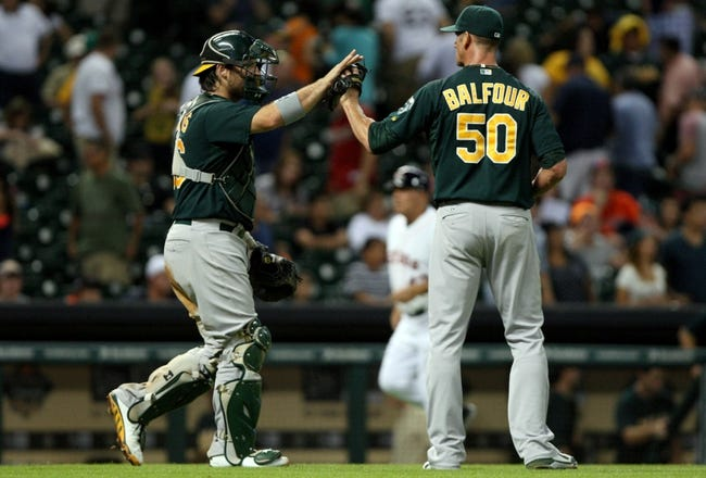 Jul 22, 2013; Houston, TX, USA; Oakland Athletics catcher Derek Norris (36) and relief pitcher Grant Balfour (50) celebrate after defeating the Houston Astros 4-3 at Minute Maid Park. Mandatory Credit: Troy Taormina-USA TODAY Sports