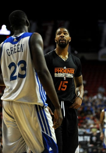 Jul 22, 2013; Las Vegas, NV, USA; Phoenix Suns forward Marcus Morris shares a word with Golden State Warriors forward Draymond Green during a stoppage in play of the NBA Summer League Championship game at the Thomas and Mack Center. Golden State won the game 91-77 to remain undefeated during the Summer League games. Mandatory Credit: Stephen R. Sylvanie-USA TODAY Sports