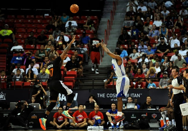 Jul 22, 2013; Las Vegas, NV, USA; Golden State Warriors guard Kent Bazemore takes a shot over lunging Phoenix Suns forward P.J. Tucker during the NBA Summer League Championship game at the Thomas and Mack Center. Golden State won the game 91-77 to remain undefeated during the Summer League games. Mandatory Credit: Stephen R. Sylvanie-USA TODAY Sports