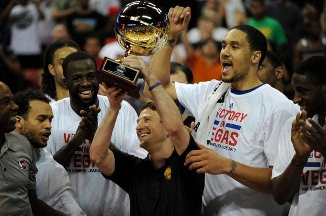 Jul 22, 2013; Las Vegas, NV, USA; Golden State Warriors head coach Darren Erman lifts the NBA Summer League Championship trophy with his players after defeating the Phoenix Suns in the final NBA Summer League game 91-77 at the Thomas and Mack Center. Mandatory Credit: Stephen R. Sylvanie-USA TODAY Sports