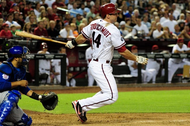 Jul 22, 2013; Phoenix, AZ, USA;  Arizona Diamondbacks first baseman Paul Goldschmidt (44) hits and RBI single during the sixth inning against the Chicago Cubs at Chase Field. Mandatory Credit: Matt Kartozian-USA TODAY Sports
