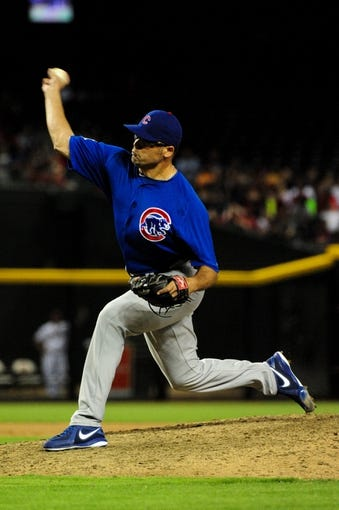 Jul 22, 2013; Phoenix, AZ, USA;  Chicago Cubs relief pitcher Kevin Gregg (63) throws during the ninth inning against the Arizona Diamondbacks at Chase Field. Mandatory Credit: Matt Kartozian-USA TODAY Sports