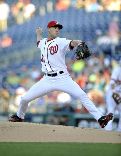 Jul 23, 2013; Washington, DC, USA; Washington Nationals starting pitcher Taylor Jordan (38) throws in the first inning against the Pittsburgh Pirates at Nationals Park. Mandatory Credit: Joy R. Absalon-USA TODAY Sports