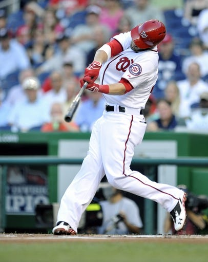 Jul 23, 2013; Washington, DC, USA; Washington Nationals left fielder Bryce Harper (34) singles in the first inning against the Pittsburgh Pirates at Nationals Park. Mandatory Credit: Joy R. Absalon-USA TODAY Sports