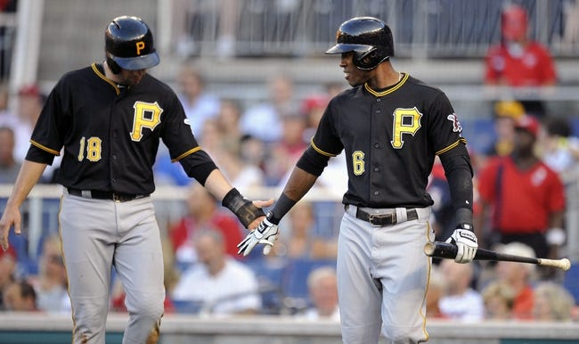 Jul 23, 2013; Washington, DC, USA; Pittsburgh Pirates second baseman Neil Walker (left) is congratulated by Starling Marte (right) after scoring in the second inning against the Washington Nationals at Nationals Park. Mandatory Credit: Joy R. Absalon-USA TODAY Sports