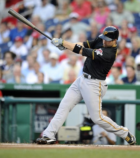 Jul 23, 2013; Washington, DC, USA; Pittsburgh Pirates second baseman Neil Walker (18) drives in Pedro Alvarez (not shown) in the second inning after grounding into a fielders choice at Nationals Park. Mandatory Credit: Joy R. Absalon-USA TODAY Sports