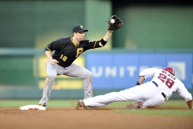 Jul 23, 2013; Washington, DC, USA; Washington Nationals right fielder Jayson Werth (28) steals second base safely as Pittsburgh Pirates second baseman Neil Walker (18) cannot make the tag in the second inning at Nationals Park. Mandatory Credit: Joy R. Absalon-USA TODAY Sports