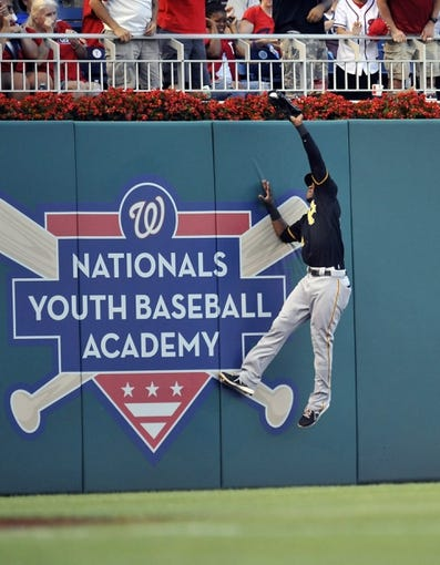 Jul 23, 2013; Washington, DC, USA; Pittsburgh Pirates left fielder Starling Marte (6) catches a fly ball by Washington Nationals first baseman Adam LaRoche (not shown) in the second inning at Nationals Park. Mandatory Credit: Joy R. Absalon-USA TODAY Sports
