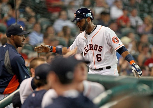 Jul 23, 2013; Houston, TX, USA; Houston Astros shortstop Jonathan Villar (6) is congratulated after scoring a run during the first inning against the Oakland Athletics at Minute Maid Park. Mandatory Credit: Troy Taormina-USA TODAY Sports
