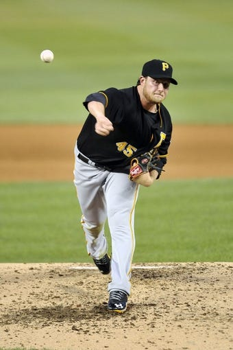 Jul 23, 2013; Washington, DC, USA; Pittsburgh Pirates starting pitcher Gerrit Cole (45) throws in the fifth inning against the Washington Nationals at Nationals Park. Mandatory Credit: Joy R. Absalon-USA TODAY Sports