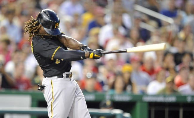 Jul 23, 2013; Washington, DC, USA; Pittsburgh Pirates center fielder Andrew McCutchen (22) singles in the sixth inning against the Washington Nationals at Nationals Park. Mandatory Credit: Joy R. Absalon-USA TODAY Sports