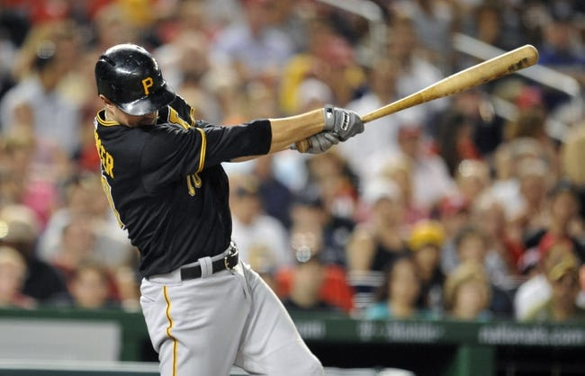 Jul 23, 2013; Washington, DC, USA; Pittsburgh Pirates shortstop Jordy Mercer (10) singles in the seventh inning against the Washington Nationals at Nationals Park. Mandatory Credit: Joy R. Absalon-USA TODAY Sports