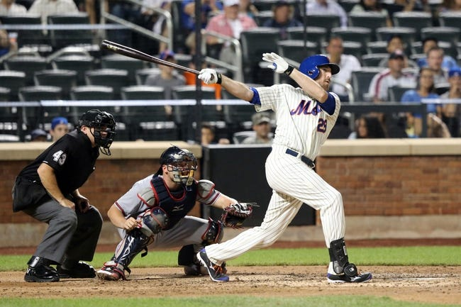 Jul 23, 2013; New York, NY, USA;  New York Mets first baseman Ike Davis (29) doubles to deep right allowing a runner to score during the sixth inning against the Atlanta Braves at Citi Field.  Mandatory Credit: Anthony Gruppuso-USA TODAY Sports