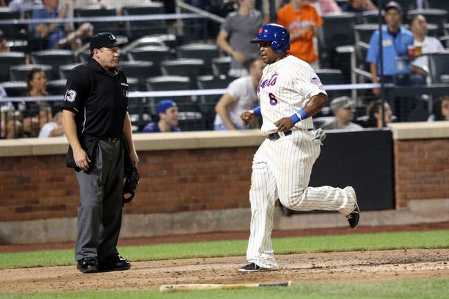 Jul 23, 2013; New York, NY, USA;  New York Mets right fielder Marlon Byrd (6) crosses the plate to score during the sixth inning against the Atlanta Braves at Citi Field.  Mandatory Credit: Anthony Gruppuso-USA TODAY Sports