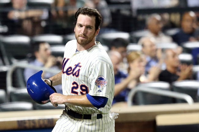 Jul 23, 2013; New York, NY, USA; New York Mets first baseman Ike Davis (29) heads to the dugout after scoring during the sixth inning against the Atlanta Braves at Citi Field.  Mandatory Credit: Anthony Gruppuso-USA TODAY Sports