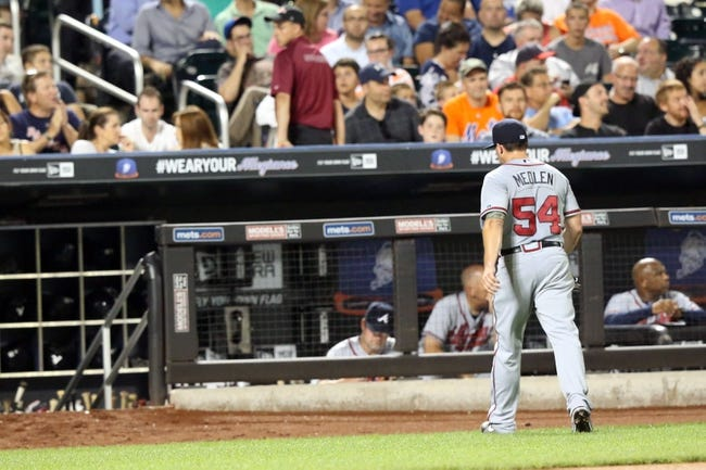 Jul 23, 2013; New York, NY, USA; Atlanta Braves starting pitcher Kris Medlen (54) heads to the dugout after being relieved during the sixth inning against the New York Mets  at Citi Field.  Mandatory Credit: Anthony Gruppuso-USA TODAY Sports