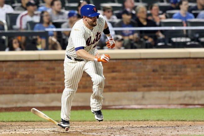 Jul 23, 2013; New York, NY, USA;  New York Mets catcher John Buck (44) singles to center allowing a runner to score during the sixth inning against the Atlanta Braves at Citi Field.  Mandatory Credit: Anthony Gruppuso-USA TODAY Sports