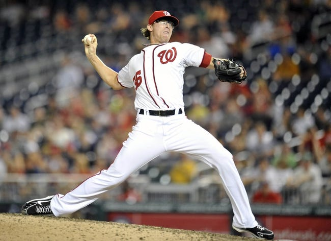 Jul 23, 2013; Washington, DC, USA; Washington Nationals pitcher Tyler Clippard (36) throws in the ninth inning against the Pittsburgh Pirates at Nationals Park. The Pirates defeated the Nationals 5-1. Mandatory Credit: Joy R. Absalon-USA TODAY Sports