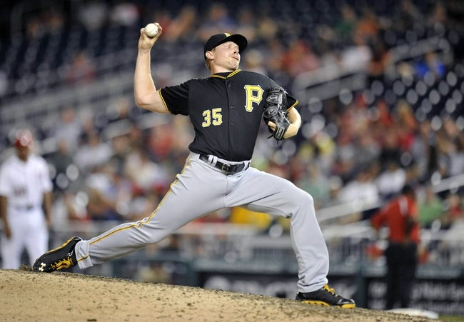 Jul 23, 2013; Washington, DC, USA; Pittsburgh Pirates pitcher Mark Melancon (35) throws in the ninth inning against the Washington Nationals at Nationals Park. The Pirates defeated the Nationals 5-1. Mandatory Credit: Joy R. Absalon-USA TODAY Sports