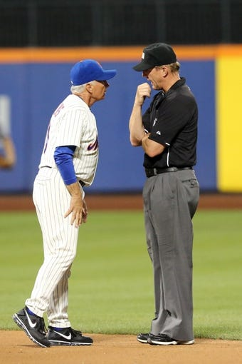 Jul 23, 2013; New York, NY, USA;  New York Mets manager Terry Collins (10) argues a call with umpire Jeff Kellogg (8) during the seventh inning against the Atlanta Braves at Citi Field.  Mandatory Credit: Anthony Gruppuso-USA TODAY Sports